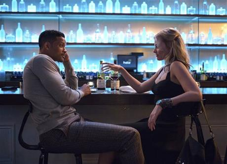 In this image released by Warner Bros. Pictures, Will Smith and Margot Robbie, right, appear in a scene from Focus. (AP Photo/Warner Bros. Pictures)