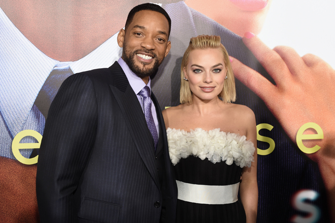 "Will Smith, left, and Margot Robbie arrive at the world premiere of ""Focus"" at the TCL Chinese Theatre on Tuesday, Feb. 24, 2015, in Los Angeles. (Photo by Chris Pizzello/Invision/AP)"